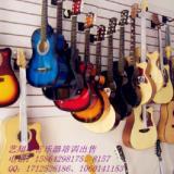 供应城阳吉他班城阳古筝班艺翔琴行专业乐器培训 架子鼓钢琴小提琴等